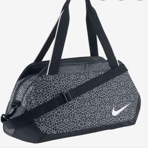 Nike gym duffel in Nike Legend print